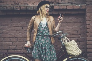Girl on Bike with Phone